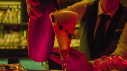 Bartender crafting an ocean themed cocktail